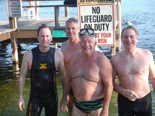 Ron Davis set the 70-74 age group record today with a time of 39:50.  Ron is seen with his posse that accompanied him during the crossing.  It was the first time that he had done a crossing without a pull buoy. Ron also tells me that he finally earned his 200K shirt.
